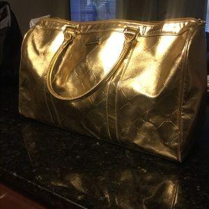 Gold BCBG travel bag